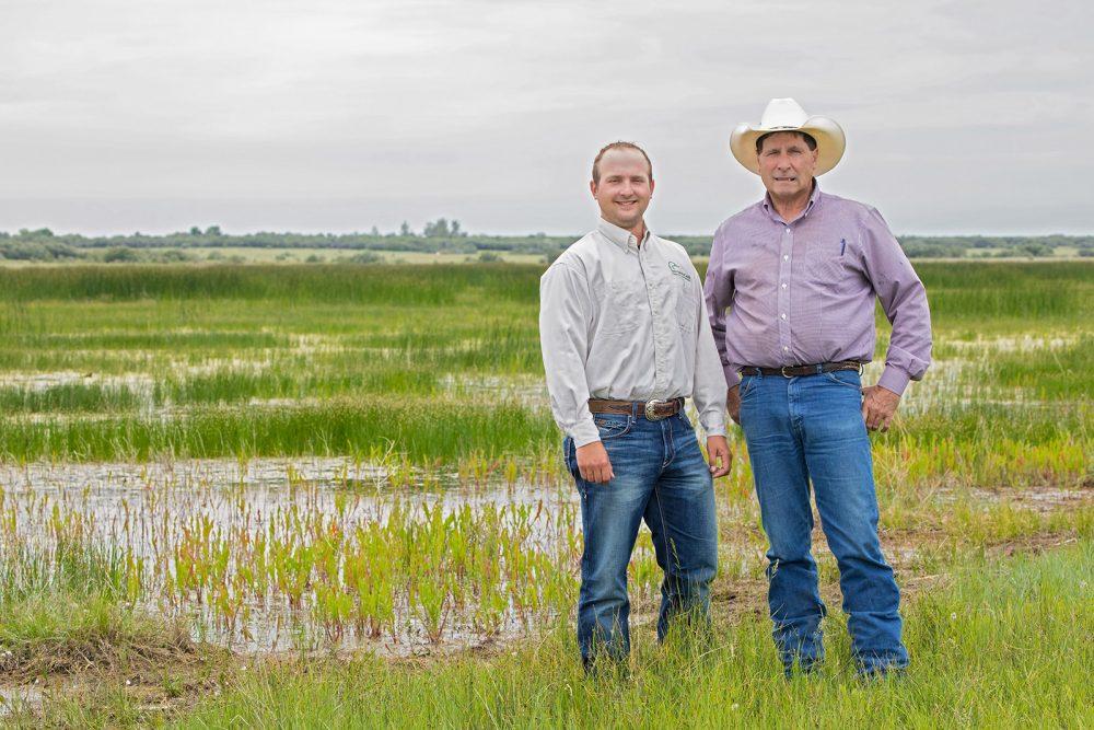 Jonathan Pool, DUC conservation program specialist, and landowner Bob McKnight.