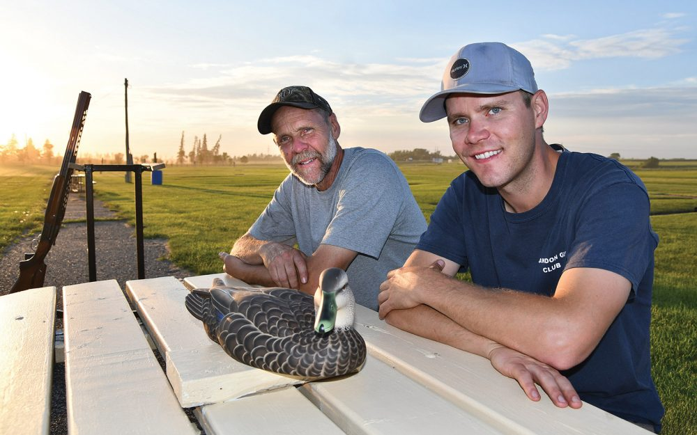 Champion trapshooters Rob (left) and Pat Lamont pose at their local shooting range with the decoy DUC presented to Rob for his 35 years of volunteerism.