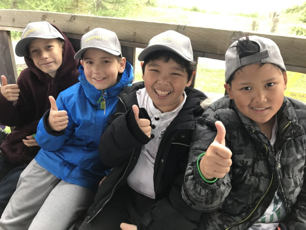 These Grade Five students were all smiles as they learned about wetlands and conservation during DUC's Wetland Discovery Days at the John E. Poole Interpretive Wetland located near Edmonton, Alta. Hands-on learning opportunities, like this one, are made possible thanks to the generous support of individuals, foundations and corporations such as AltaLink and Finning.