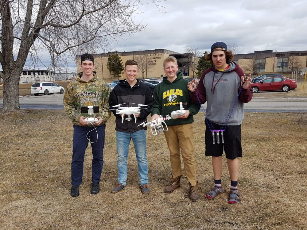 Pictured left to right are Fredericton High School students David Nash, Nathan Hoyt, Will Marshall and Brandyn Cooke. Using 3D printing and software, robotics, coding, as well as their problem-solving skills and ingenuity, this group developed a drone attachment capable of collecting water samples.