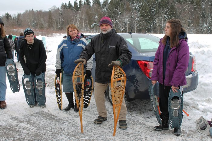 Parks New Brunswick nature educator Ian Smith teaches Saint John high schoolers about snowshoeing.