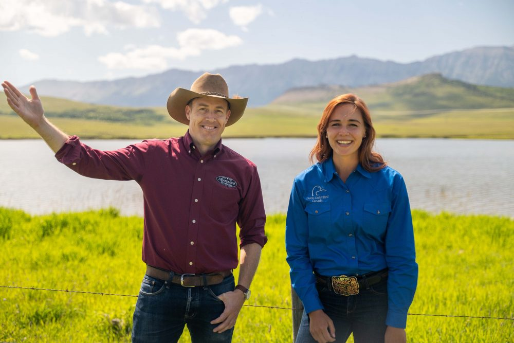 Tom Lynch-Staunton, ABP's government relations and policy manager, and Mickenzie Plemel-Stronks, DUC's cattle industry liaison, will be working closely on several initiatives to support the cattle industry and its efforts to conserve native grasslands and wetlands. They are pictured here on a ranch located near Lundbreck, Alta.
