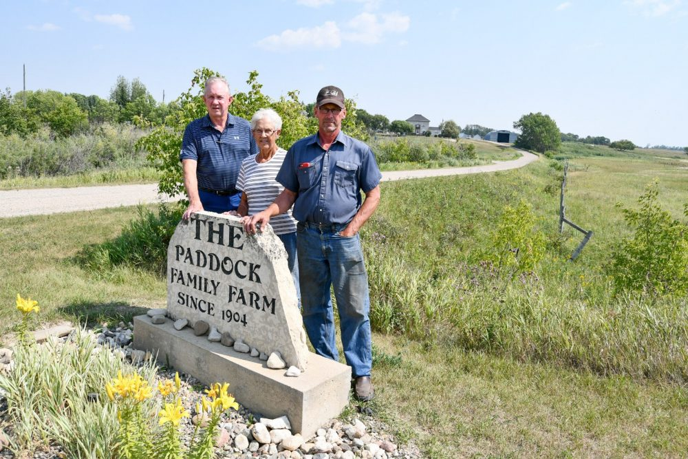 John (left), Alvina and Gord Paddock at their family farm near Oak River, Manitoba. Brothers, John, Gord and Russell Paddock are best known for their achievements in sports, but their roots are in farming. They and their mother are now conservationists too, having signed conservation agreements with DUC.