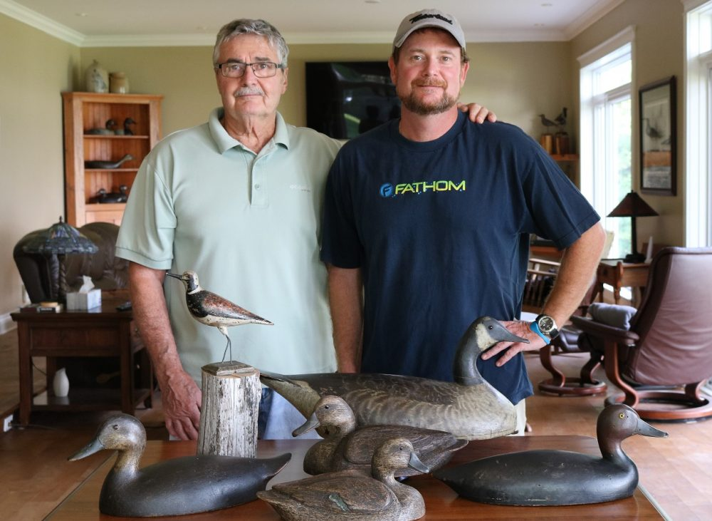John Latreille and son Kurtis with their purchases from the Peter Brown decoy auctions.