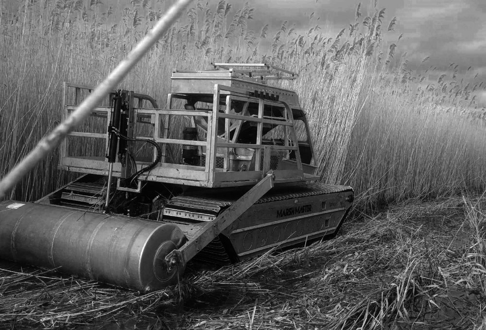 Phrag roller: DUC has been a partner in a large-scale phragmites removal program on Long Point. The invasive plant has taken hold in coastal marshes on the north shore of Lake Erie.