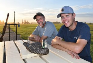 Father-and-son duo Rob Lamont and Pat Lamont are champion trapshooters…and volunteers