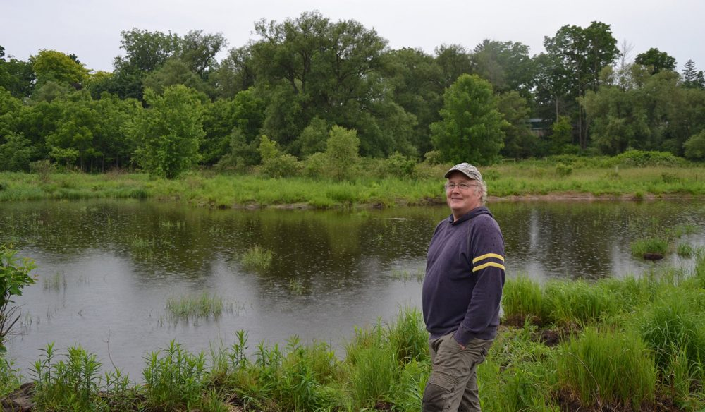 Newly minted conservationist Jeff Tribe poses proudly by the restored wetland. Tribe started the restoration process with a phone call to DUC