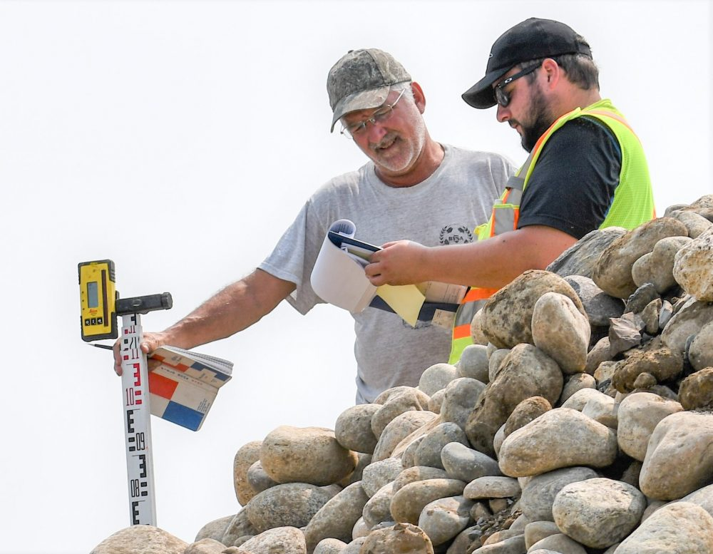 DUC engineer Dave Dobson (left) consults with fellow engineer, Patrick Lederman, as they work to replace an aging water control structure near Lenore.