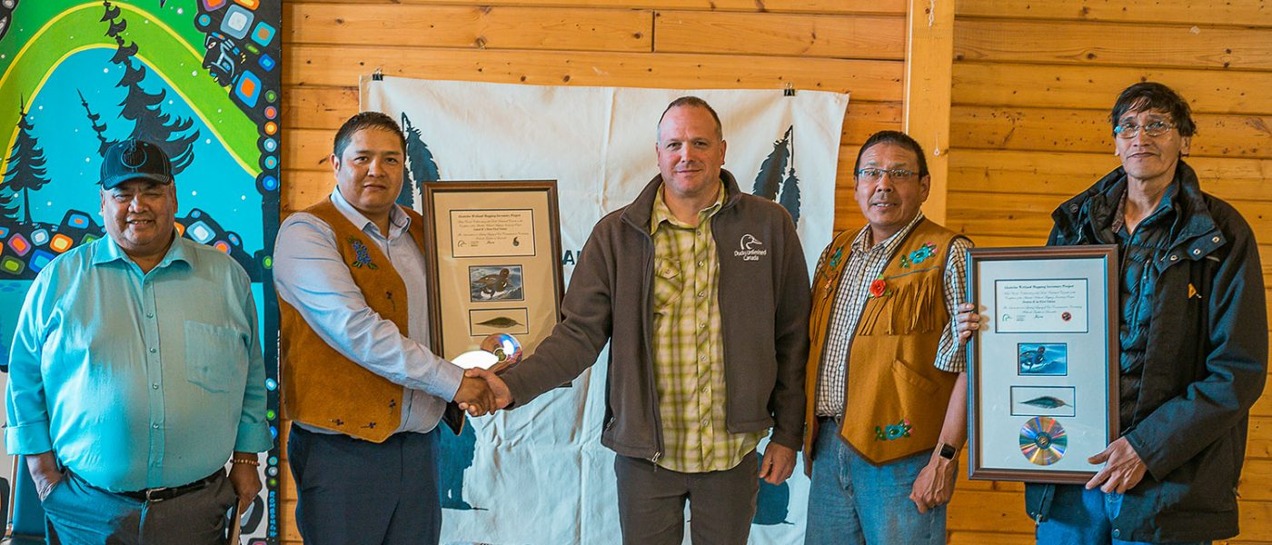 DUC's Kevin Smith  presents appreciation plaques to the Treaty 8 Tribal Council at the Akaitcho General Assembly. From (L), Chief Edward Sangris, Chief Darryl Boucher-Marlowe, Kevin Smith, Chief Ernest Betsina, and Councillor Pat Simon. Chief Louis Balsillie from Deninu K'ue First Nation was also among the participants.