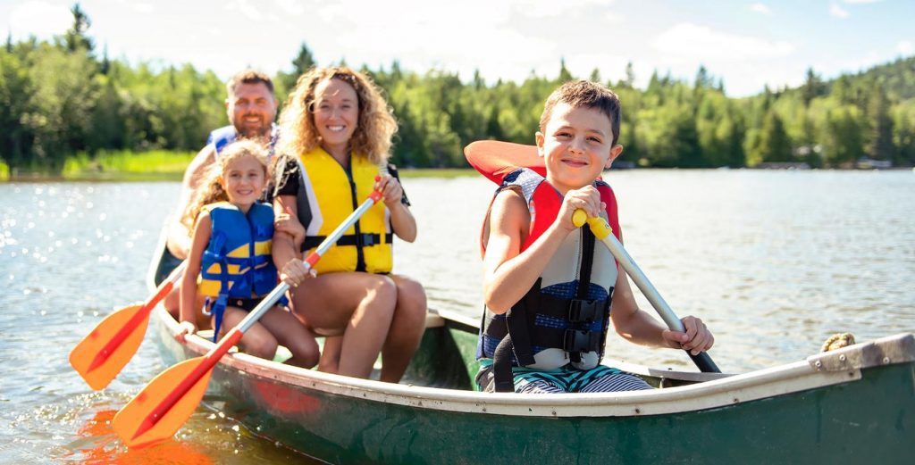 Photo of a family canoeing together