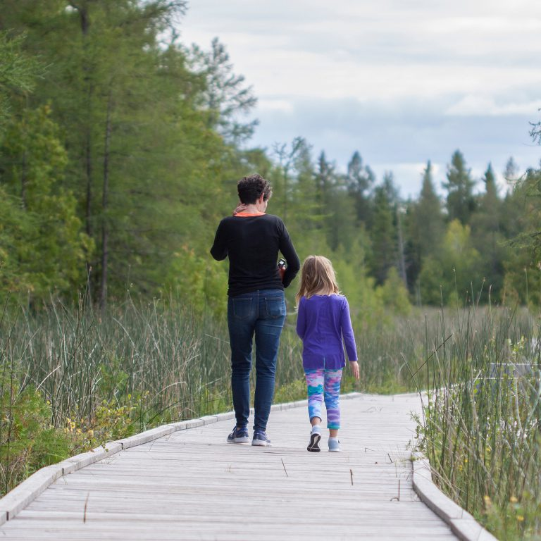 Mother and daughter walking on a dock