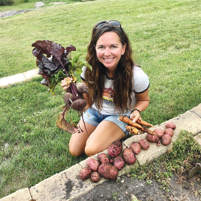Michelle Trudeau harvests vegetables from her garden at Black Sturgeon Lake, Ont