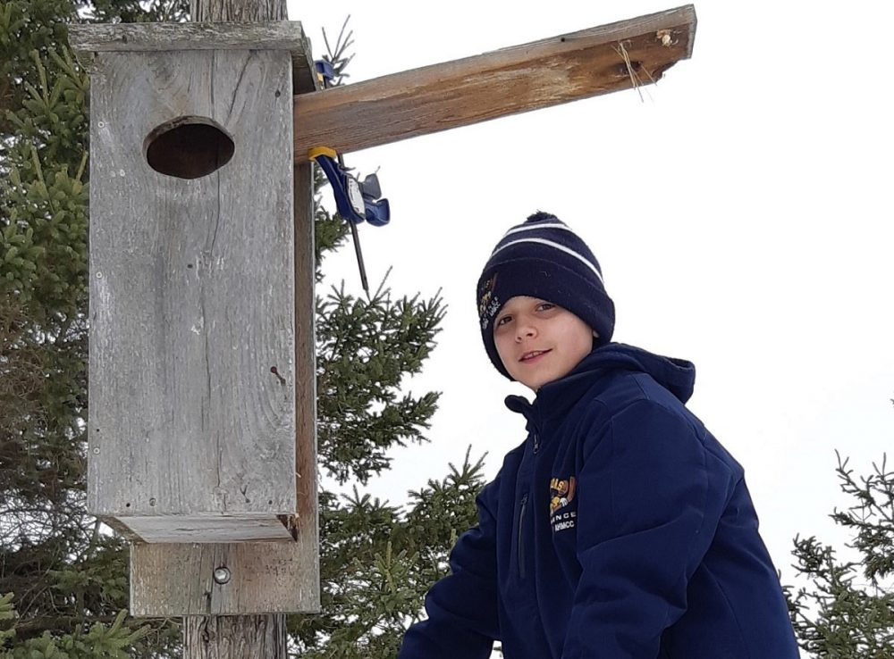 Liam McMullen volunteered to clean up duck nest boxes at a WCE in Ottawa and earned recognition as a DUC Wetland Hero.