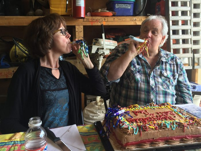 Paul Usher joins fellow DUC employee Patti Erickson as the two celebrate their birthdays at the DUC warehouse in Kamloops.