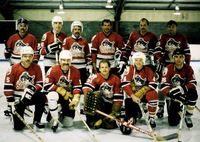 Paul Usher, back left, with his fellow DUC friends playing hockey in Alberta.