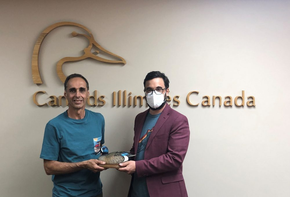 Bernard Filion, left, receives his National Blue-winged Teal Award from incoming DUC provincial manager for Quebec, Sébastien Rioux, June 21, 2021.