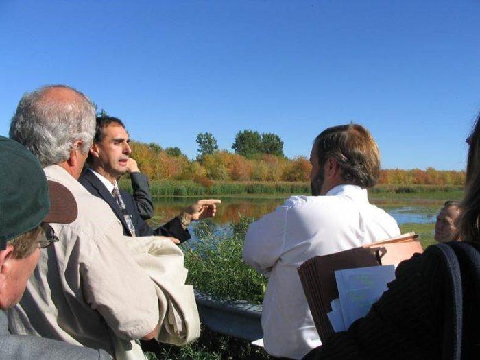 Bernard Filion explains a DUC Quebec project site to a group of visitors.