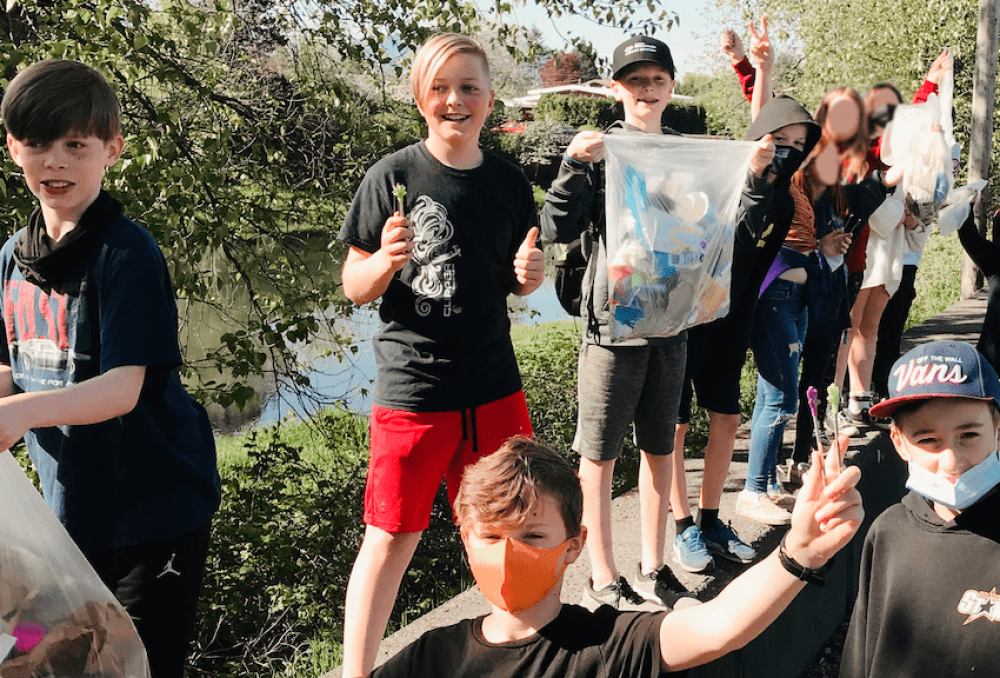 Grade 6 students from Chilliwack Middle School pose for a picture after cleaning up Hope Slough