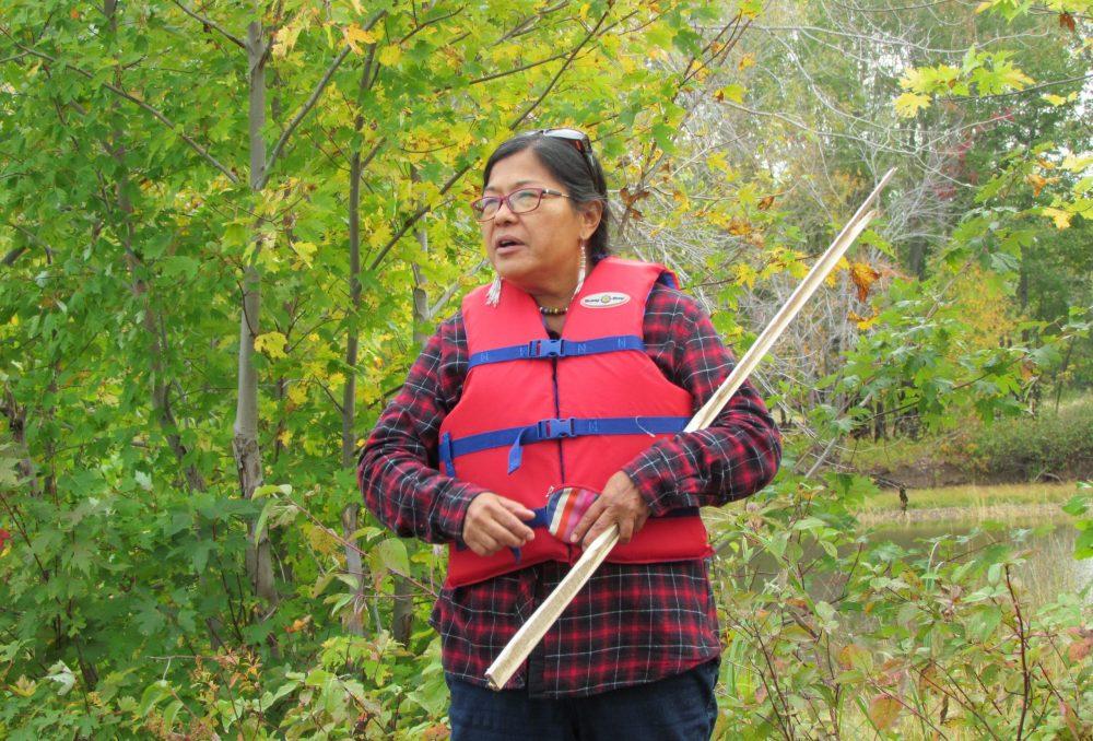 Cecelia Brooks speaks to the wild rice harvest participants.