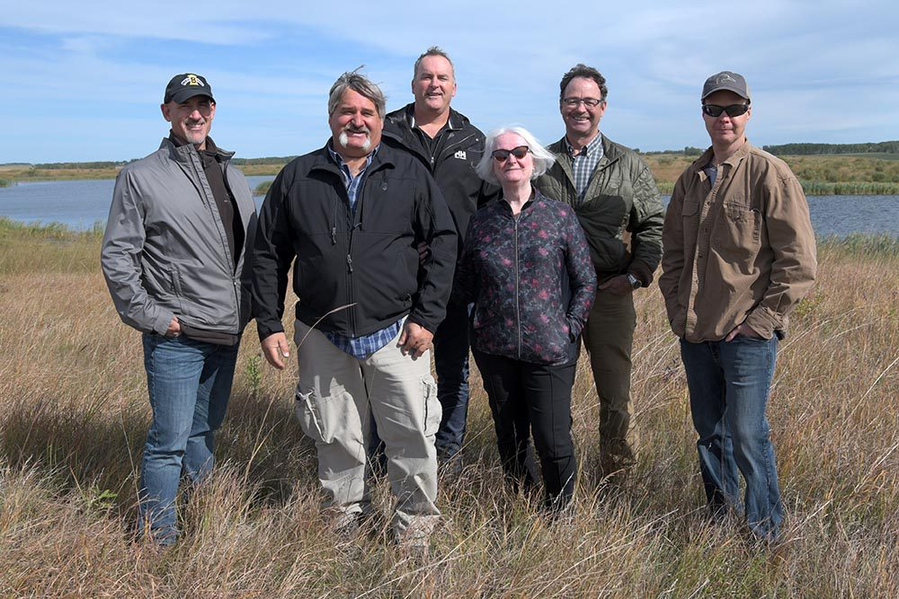 Glen Babee with Ducks Unlimited Canada staff near near Riding Mountain National Park on marsh and grassland that he helped restore.
