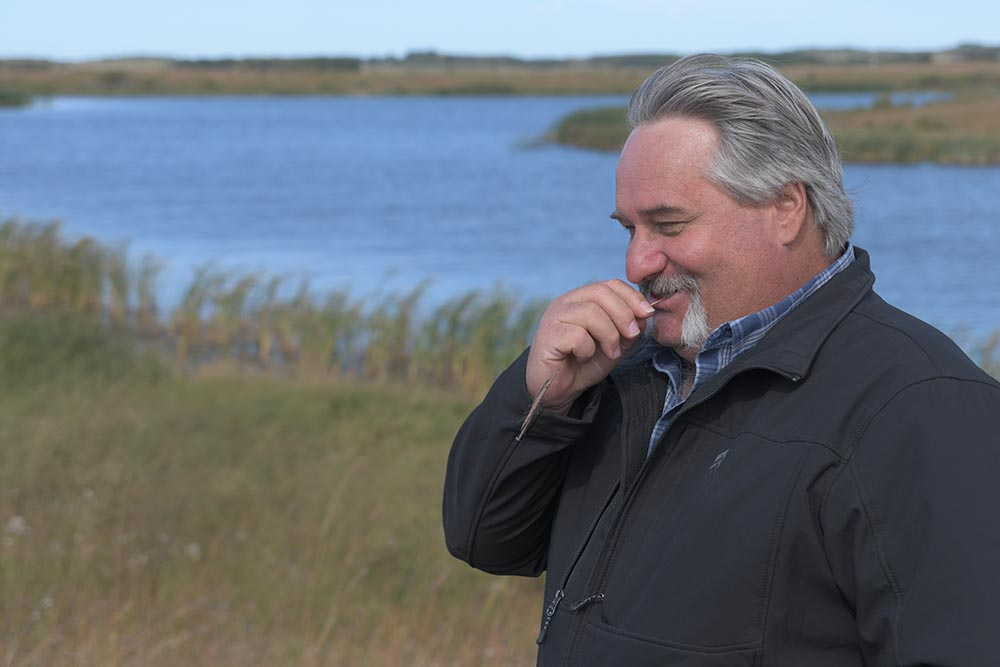 Glenn Babee on marsh and grassland near Riding Mountain National Park that he helped restore with Ducks Unlimited Canada.