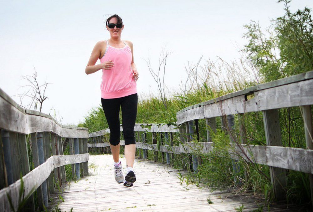 Writer Amanda Hope enjoys a noon-hour run along the boardwalk trails of Oak Hammock Marsh, Manitoba.
